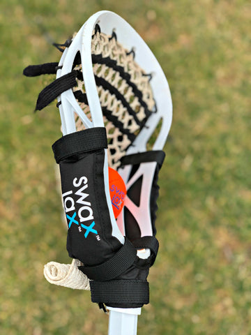 Swax Lax Power Weights shown on boy's lacrosse stick