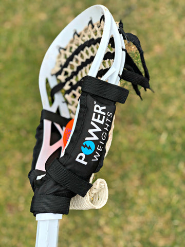 Swax Lax Power Weights shown on boy's lacrosse stick - side view