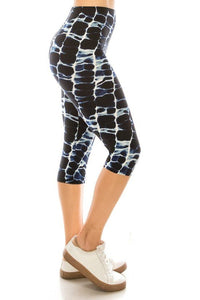 Abstract Print, High Waisted Capri Leggings In A Fitted Style With An Elastic Waistband. - Shalaunie's Closet