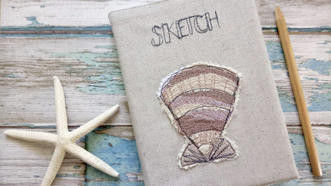Shell embroidered sketchbook