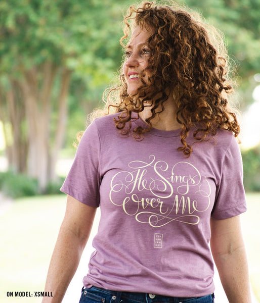 He Sings Over Me Tee – Heather Orchid