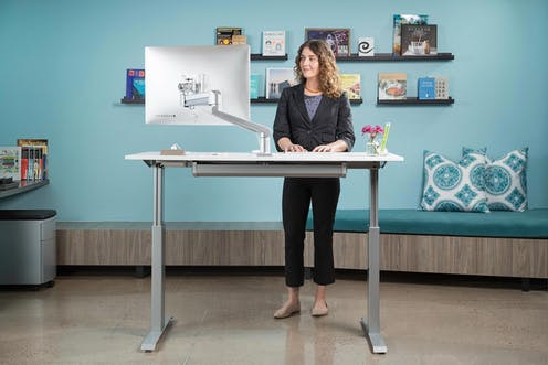 sit stand desk standing workstation height adjustable health benefits