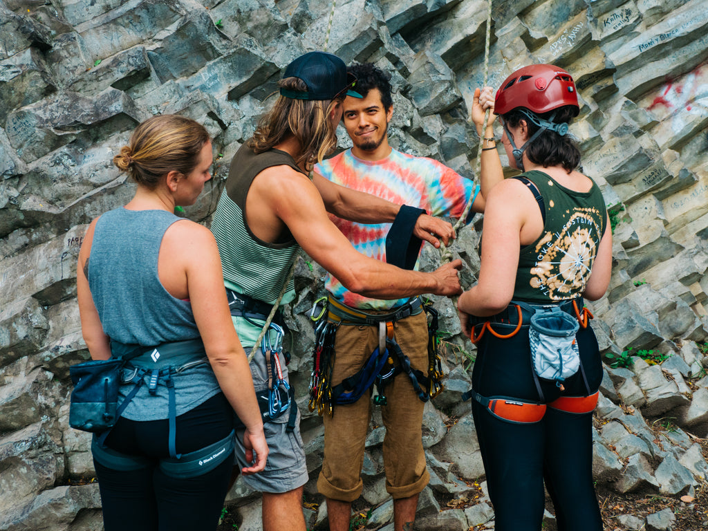 Climbers checking their figure of eight climbing knot
