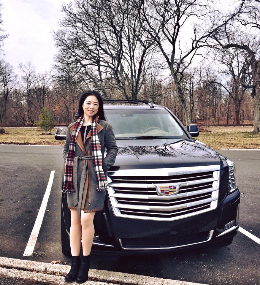 Jia Li in the luxury of the car and the Margaret reversible coat are complementary
