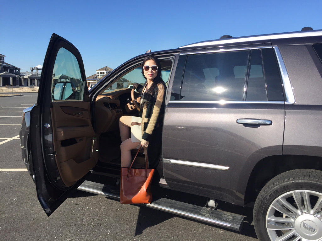 Jia Li getting out of the Cadillac 2016 Escalade wearing the Danielle sweater dress.