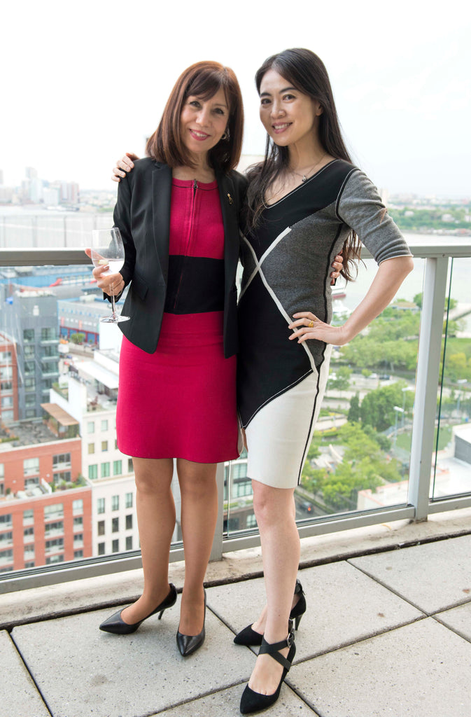Diane DiResta in the Erin Reversible dress and Jia Li in the reversible Arabella dress.