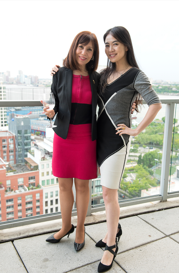 Diane DiResta  in the reversible silk/cashmere Erin dress and Jia Li in the reversible Arabella dress