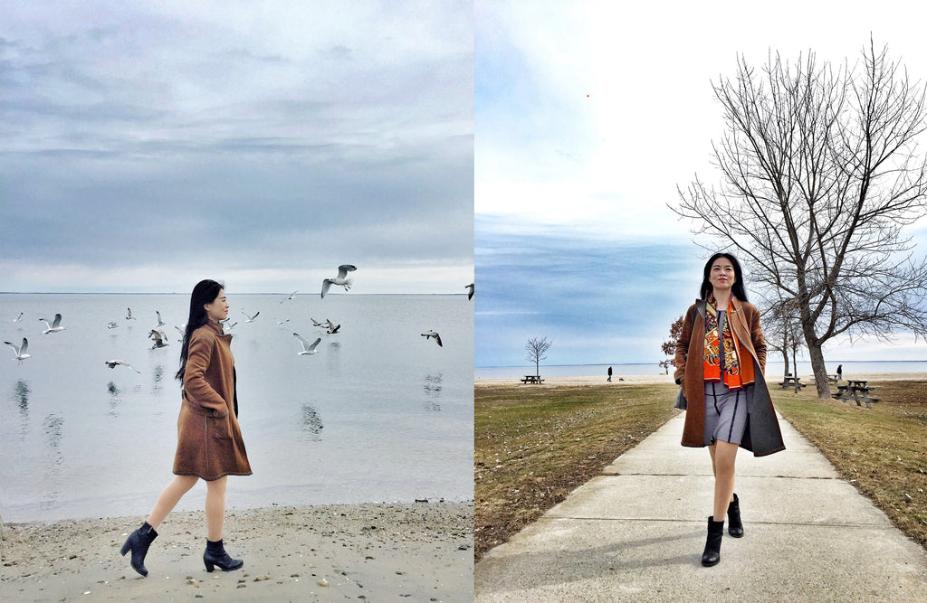 Jia Li taking a stroll by the beach and keeping warm in the Margaret reversible coat (left) layered over the Katerina reversible dress (right).