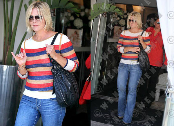 Jennie Garth wearing Elena reversible pullover brighter stripe side.