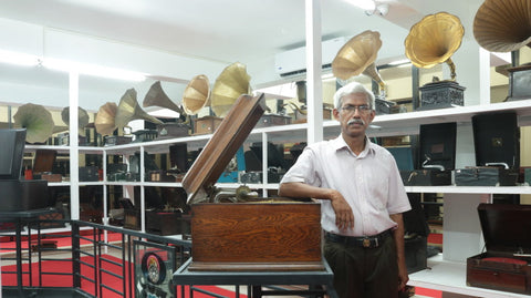 Sunny Mathew, the curator of Gramophone Museum & Records Archive, with his collection of gramophones.