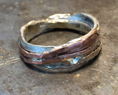 Lost and found ring of sterling, gold filled and copper.