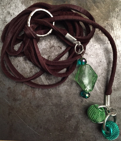 Deerskin lariat necklace with sterling silver circlet, green glass and mesh beads