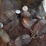 Cacoxenite necklace, mother of pearl, sterling silver clasp