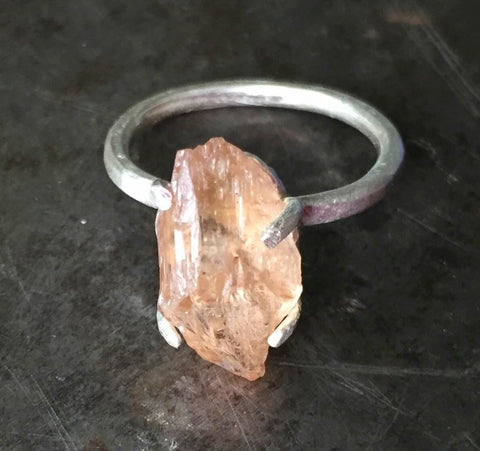 Raw Imperial topaz prong set in brushed sterling silver