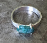 Blue green tourmaline, faceted, in fine silver ring
