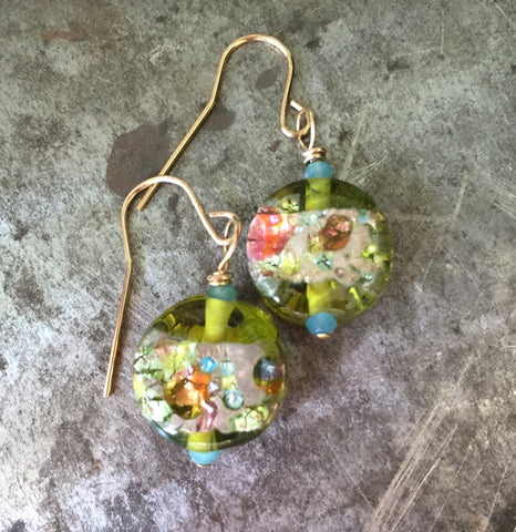 Glass bead earrings, glowing with green and the colors of spring, gold filled wire