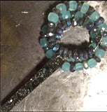 Black melanite garnet pendant, blue chalcedony and iridescent labradorite necklace