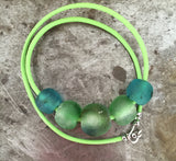 Green recycled glass bead necklace on spring green leather, sterling silver hook