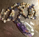 Charoite pendant on necklace of iridescent moonstone and aquamarine, freshwater pearls, amethyst silver toggle