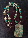 Apatite pendant, aquamarine and chrysocolla necklace, sterling silver clasp.