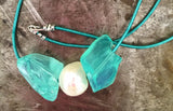 Aqua quartz and pearl necklace on turquoise leather, sterling silver clasp.