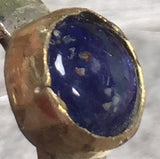 Blue sapphire cabochon ring, bezel set in 14K gold on sterling silver band