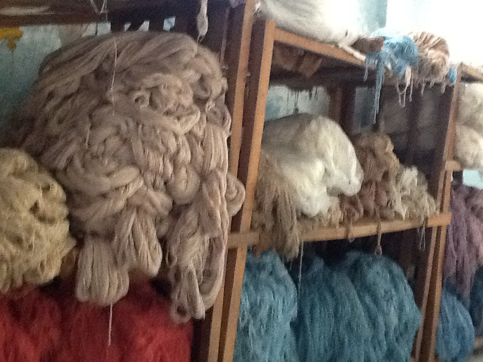 Bundles of spun wool ready to be turned into a beautiful rug - Main Street Oriental Rugs
