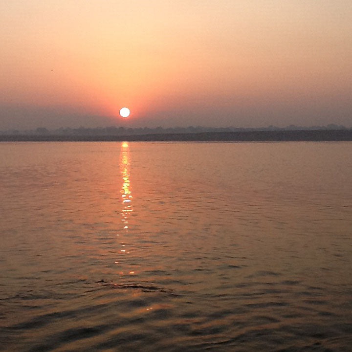 Sunset over the river in Varanasi, India - Main Street Oriental Rugs