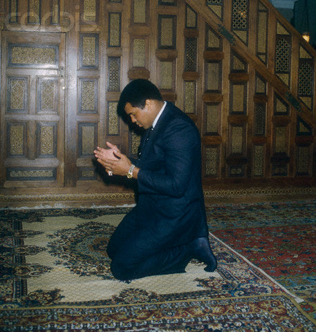 Muhammad Ali praying on Persian Rugs
