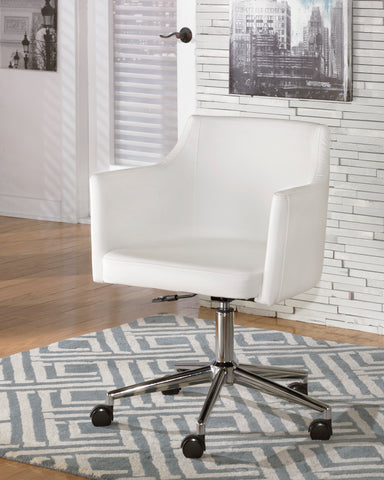 white faux leather swivel office chair. Barrel shaped seating.