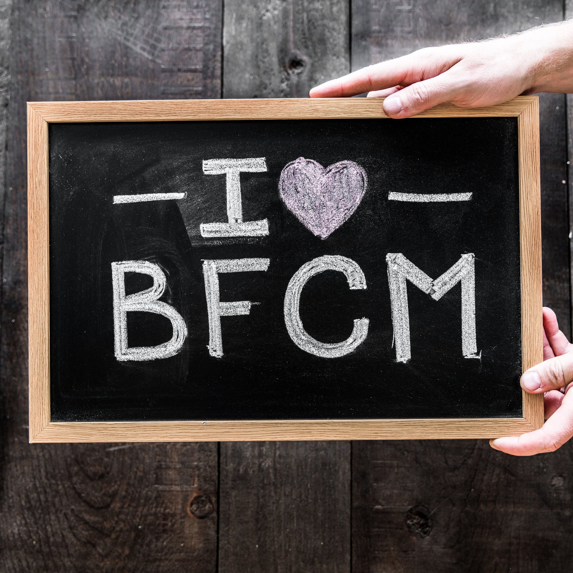 I heart black friday cyber monday or BFCM on chalkboard