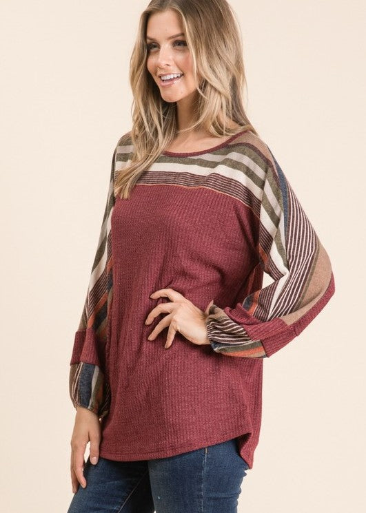 Women's Top- rust waffle top with stripes across neck and on sleeves.