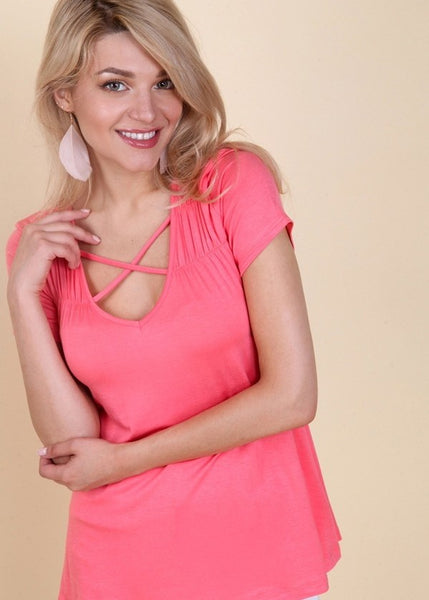 Women's Pink Short Sleeve Top with a Criss Cross Front.