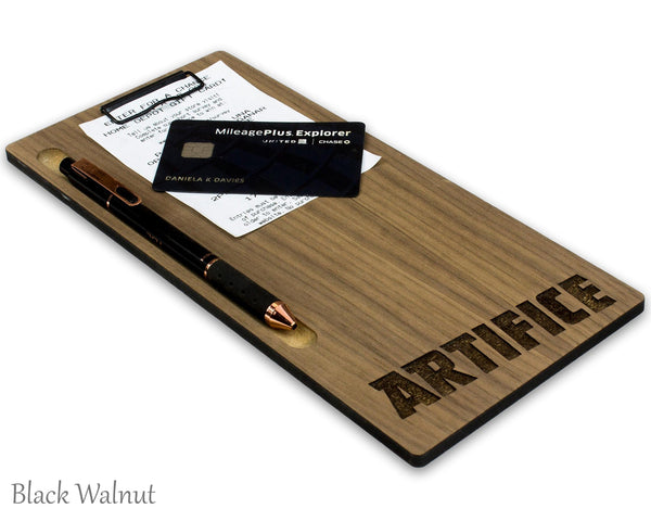 Wood check presenter with a pen and credit card attached and a custom laser engraved logo at the bottom