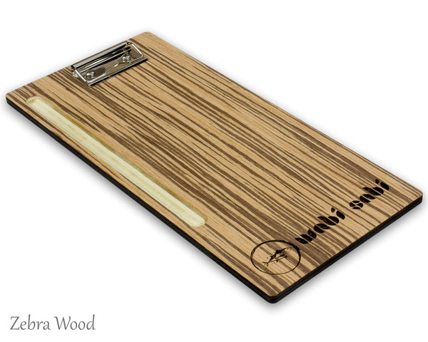 Bamboo check presenter with clip and carved pen slot shown with a custom engraved logo