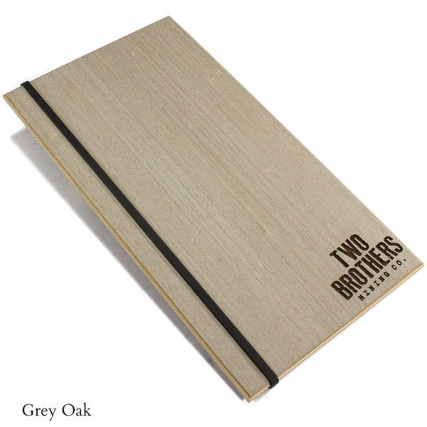 Menu holder with Grey Oak veneer and silicone band for menu books and laser engraved logo.