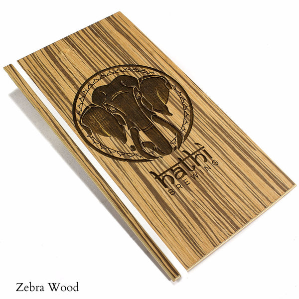 Menu holder with zebra wood veneer and silicone band on left side.