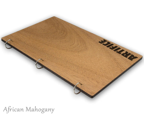 Menu holder with snap ring lying on table with mahogany veneer and custom laser engraved logo.