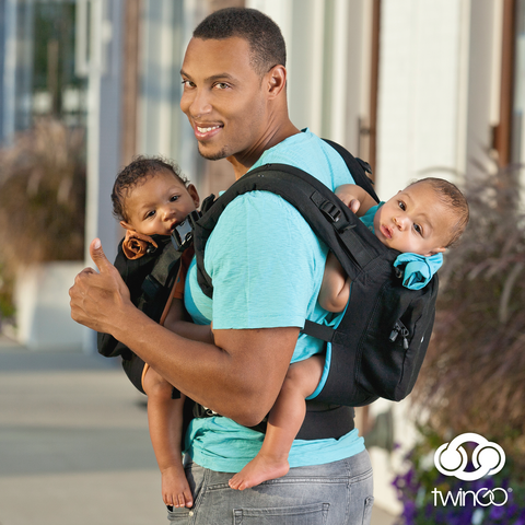 Dad carrying twins in the TwinGo Carrier