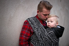 Yaro woven wrap sling for babywearing. A father carrying his baby.