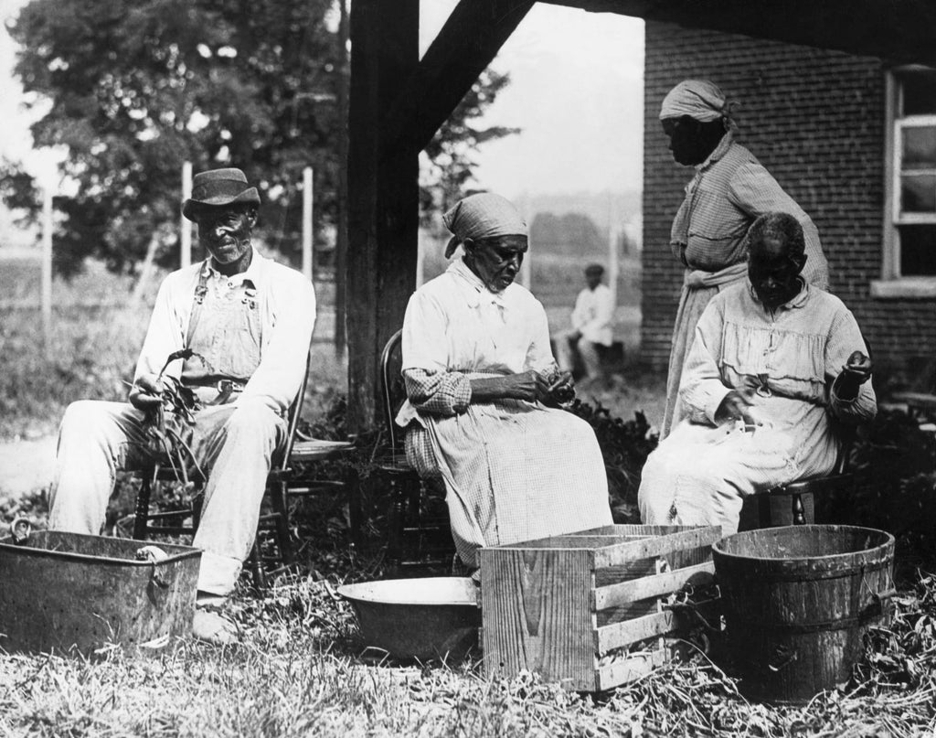 Bettman Archive | Getty Images | A group of formerly enslaved African-Americans