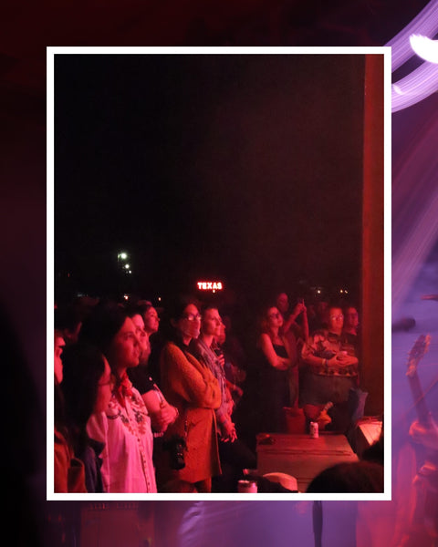 People watching the stage at Trans-Pecos, El Cosmico, Marfa Texas