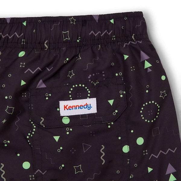 The Night Brights Swim Trunks in Black by Kennedy