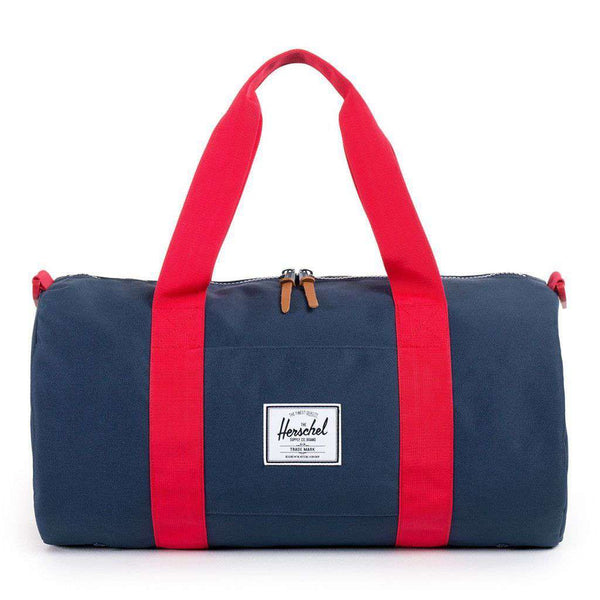 Sutton Mid Volume Duffle Bag in Navy and Red by Herschel Supply Co.