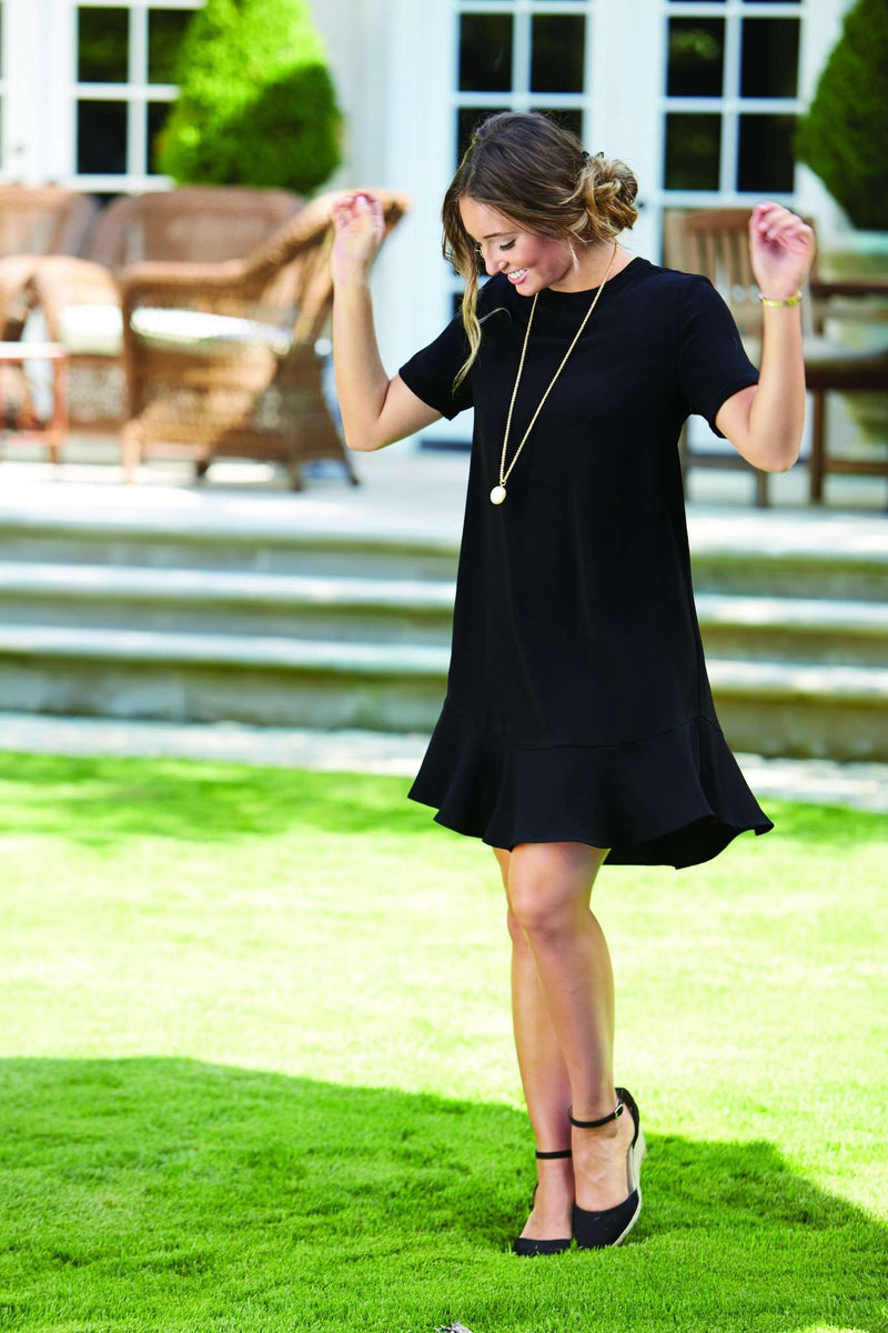 The Farrah Flounce Dress in Black by Mud Pie