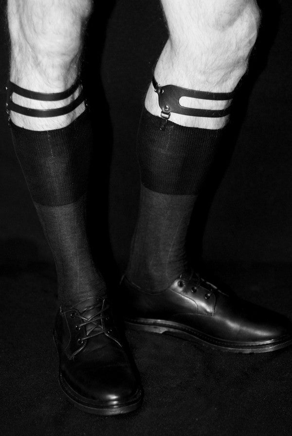 Both crew socks with garters or over-the-calf socks will obviously keep your leg covered appropriately when wearing trousers, and we wouldn't say there are drawbacks to either method. The bonus with garters is the additional way with which to style an outfit, which we're always a fan of.