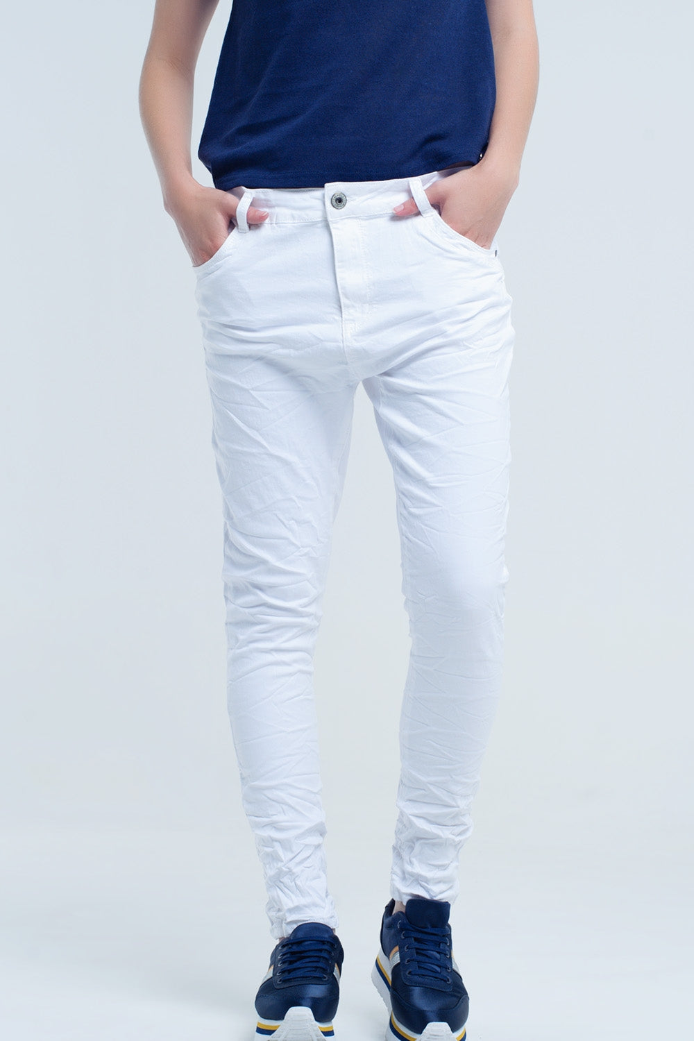 Crumpled white jeans with pockets