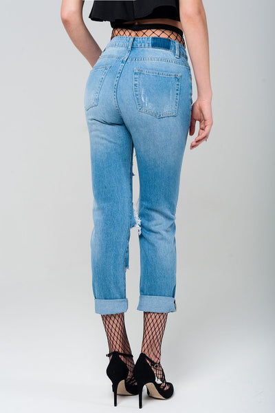 Ripped mom jeans with fishnet tights
