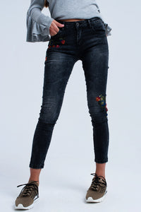 Black skinny jeans with embroidered detail