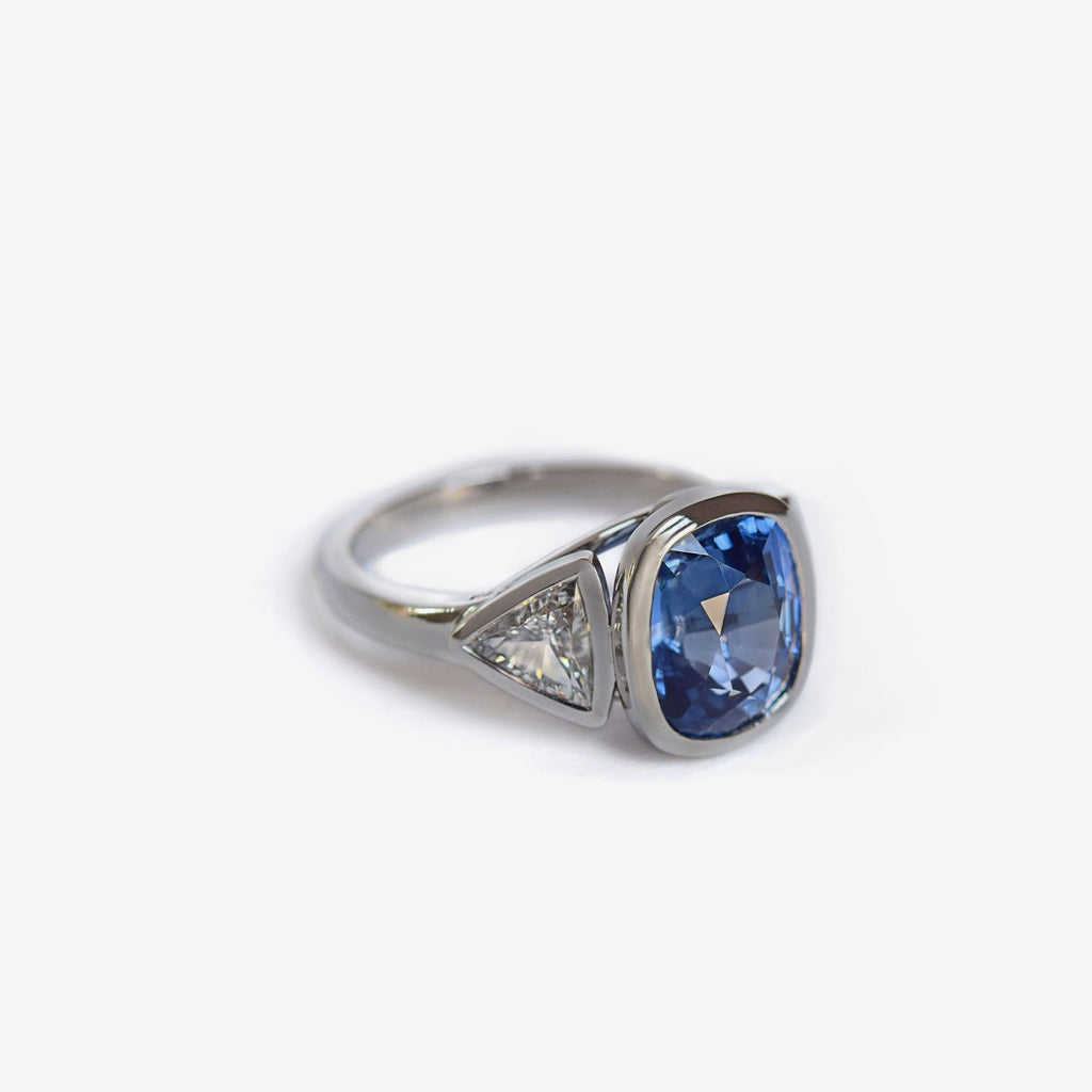 3 stone cushion cut natural blue sapphire ring with triangle diamond accents